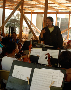 Dr. Jean Montes works with students of the Holy Trinity School of Music in Port-Au-Prince.