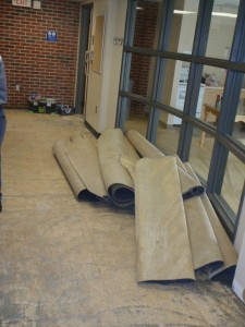 Carpet ready to be removed from the elevator lobby